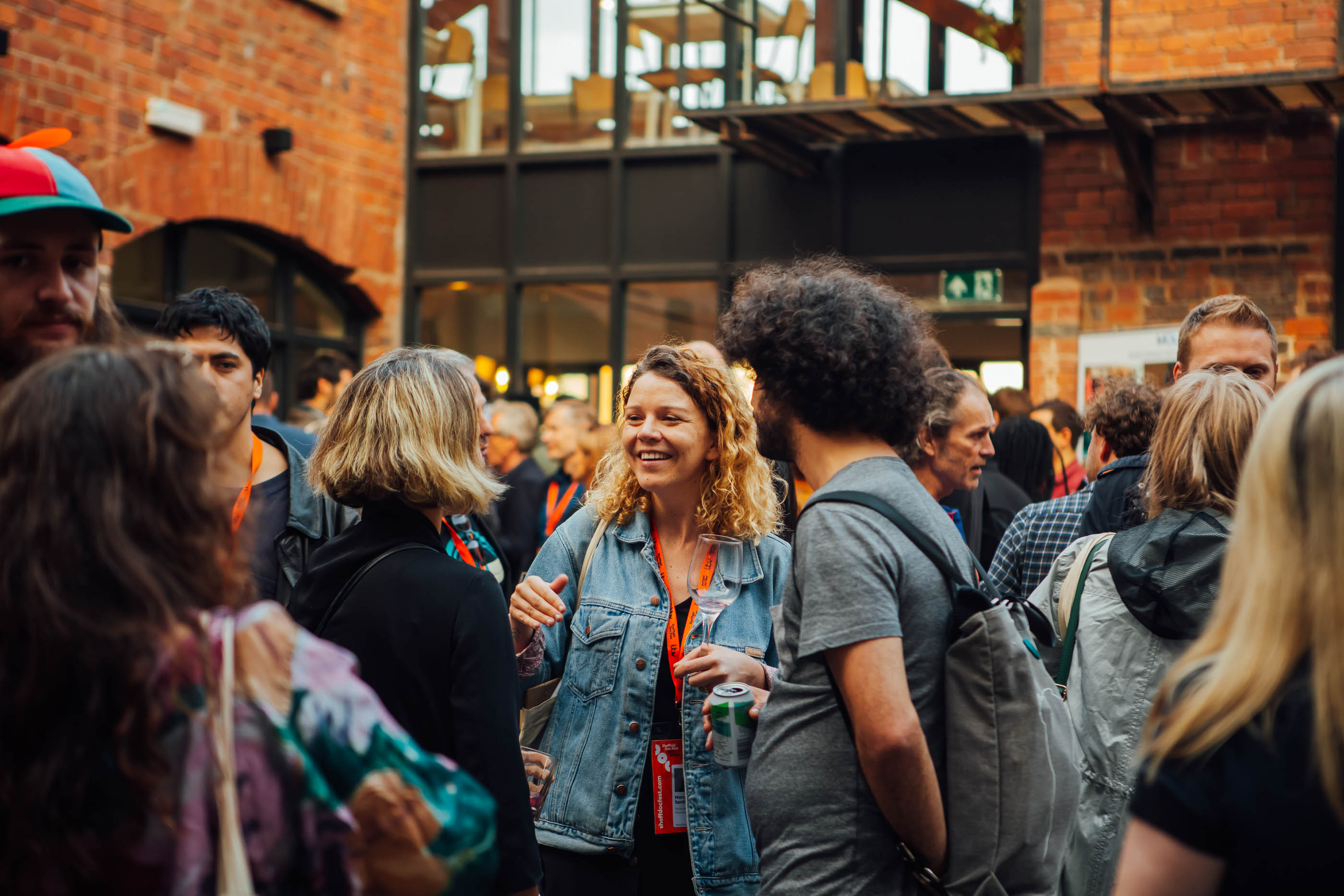 DocFest attendees enjoying a festival event in an outside venue
