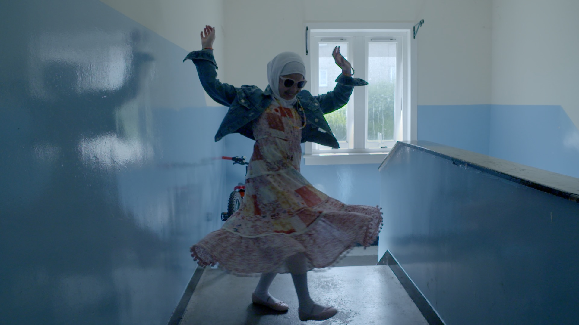 Still from Isle Of Us. A woman dancing in a corridor