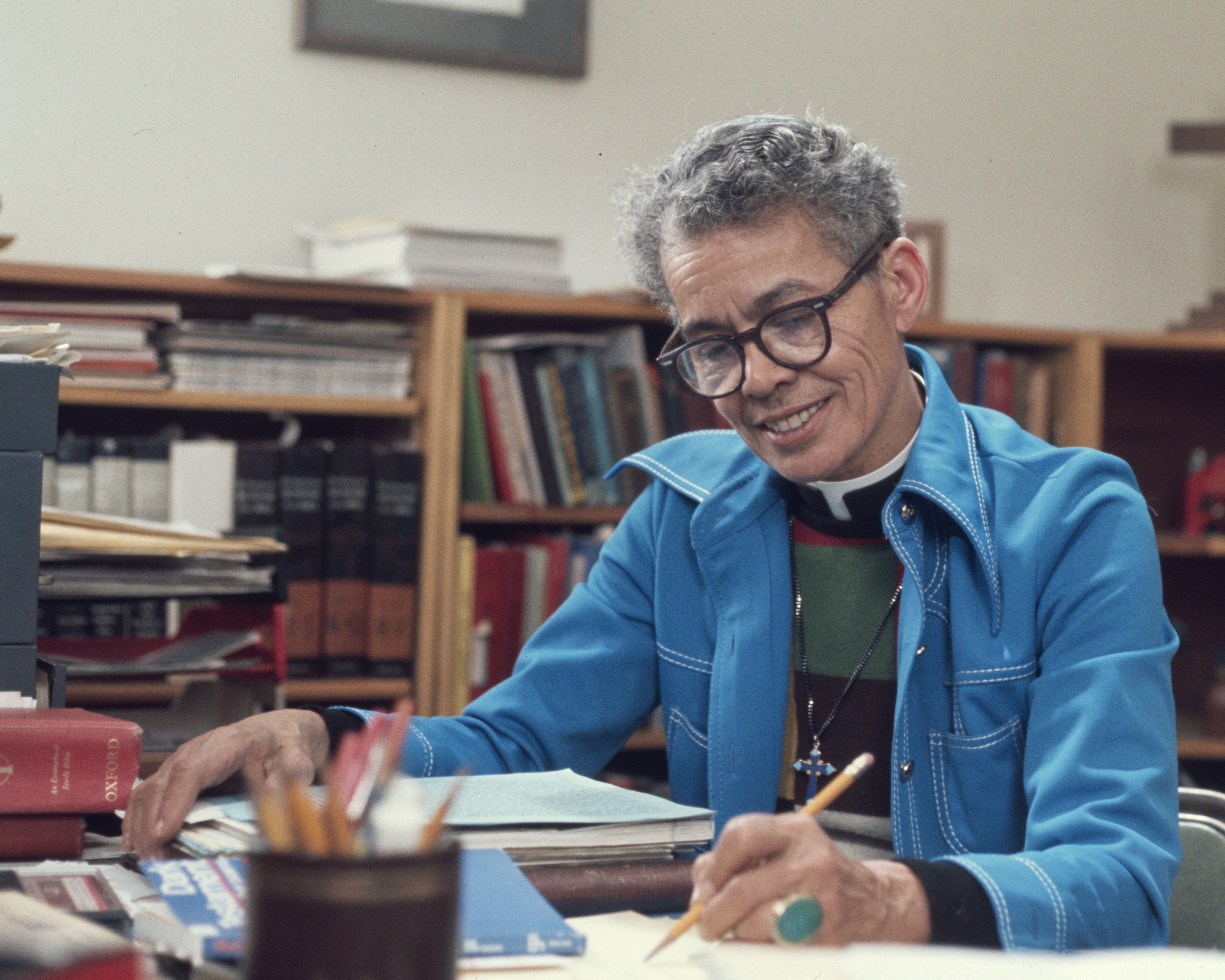 Head and shoulders shot of Pauli Murray working at a desk