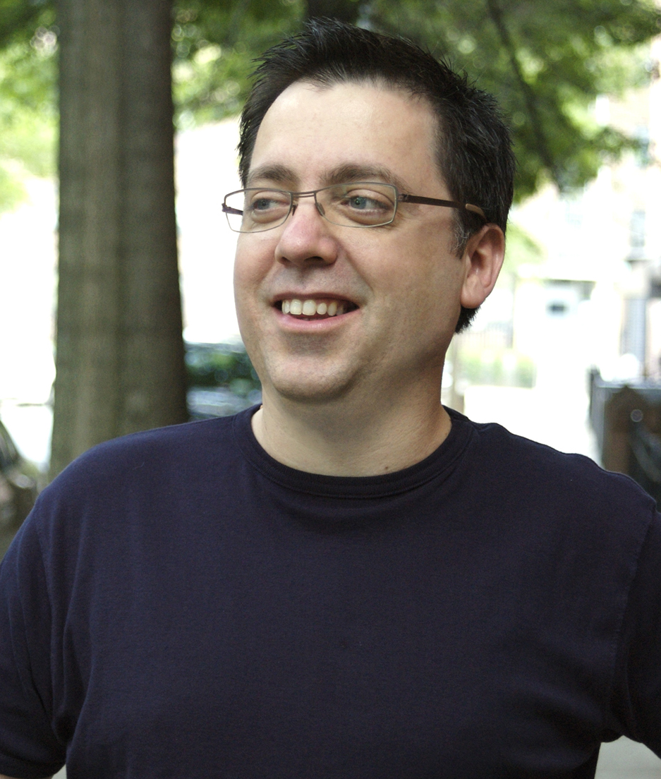 Man with glasses and dark shirt