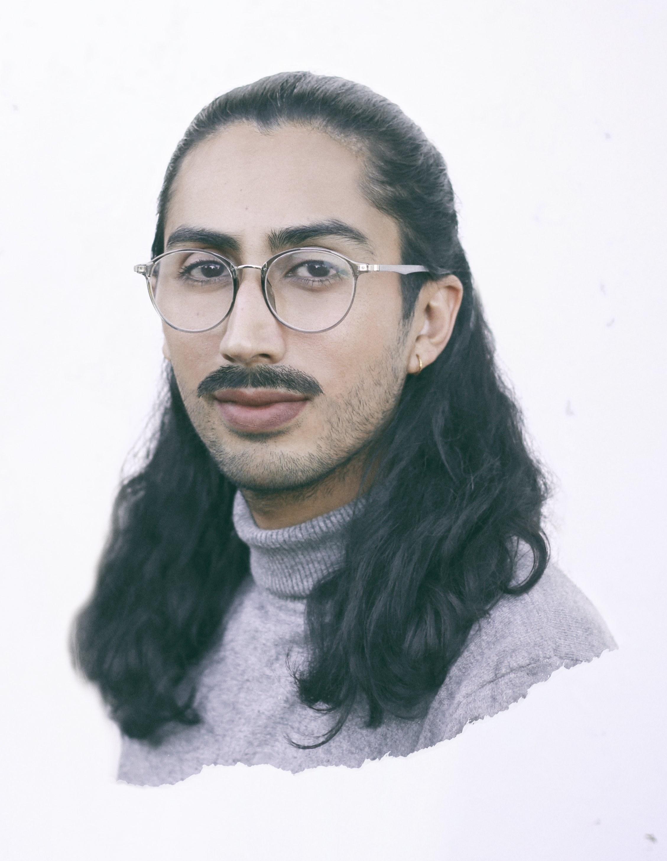 man with glasses and long brown hair