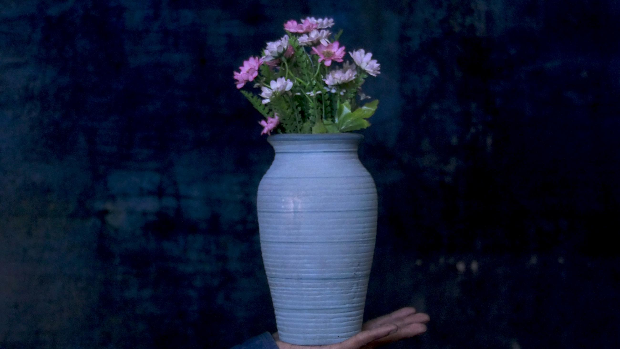 Blue vase of pink and white flowers