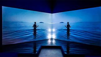 Two screens with silhouette of a person in deep blue sea