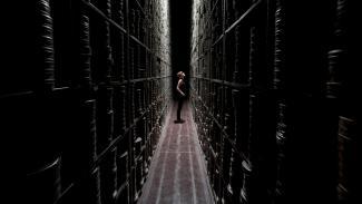 bfi-national-archive-berkhamsted-woman-stacks-corridor.jpeg