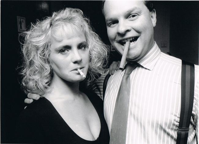 B/W photo of a man and woman both smoking cigars