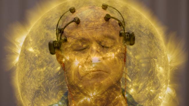 Man in a yellow aura with electrodes attached to head